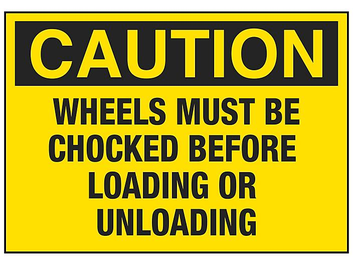 """""""Wheels Must Be Chocked Before Loading or Unloading"""" Sign"""